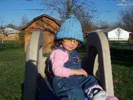 Olivia wearing a goofy hat and sunglasses.