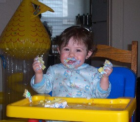 Olivia eating her first birthday cake.