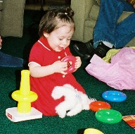 Olivia playing with birtday presents.