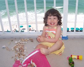 Olivia on the balcony of the beachfront condo.
